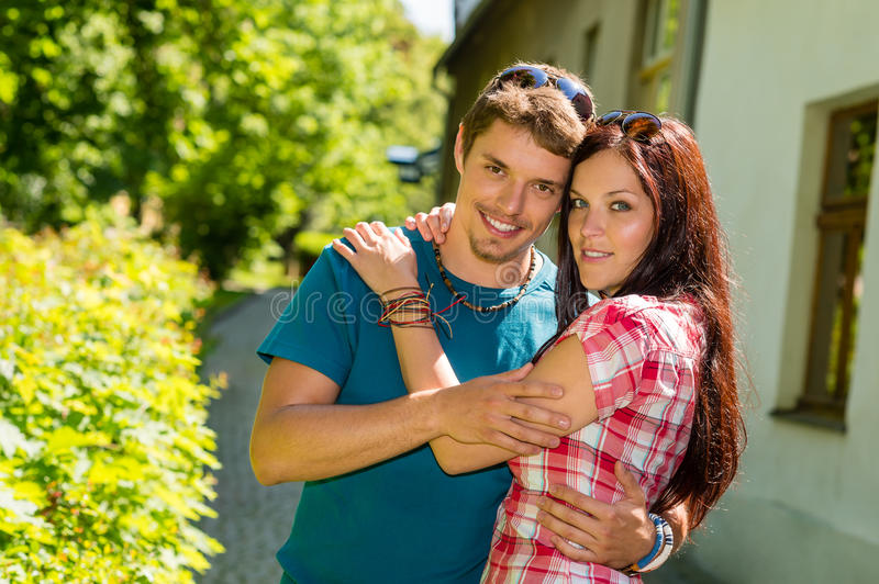 Young Happy Couple Embracing In Sunny Park Royalty Free Stock Image