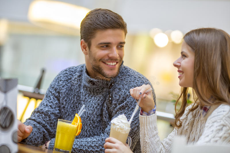 Young happy couple enjoying in coffee shop stock photography