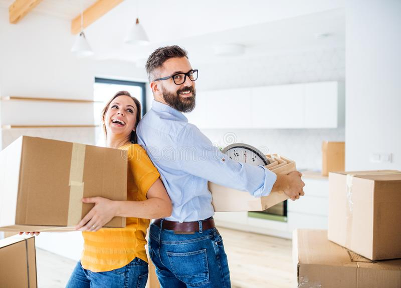 A young couple moving in new home, having fun. royalty free stock photo