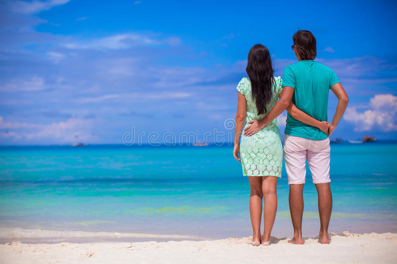 Young happy couple have fun during beach vacation. Young happy couple have fun on summer tropical vacation royalty free stock photos
