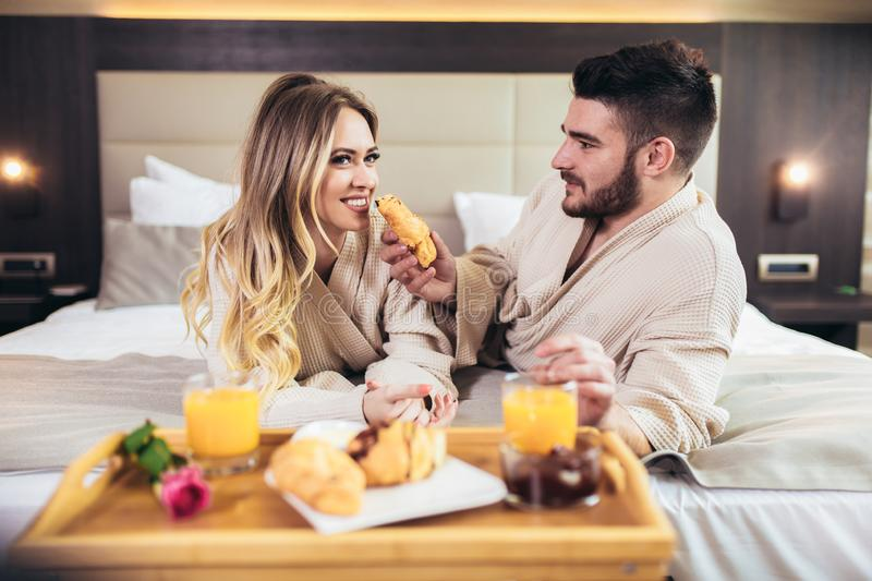 Happy couple having breakfast in luxury hotel room stock photos