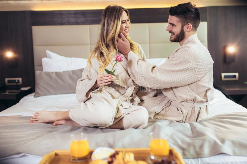 Happy couple having breakfast in luxury hotel room royalty free stock photos