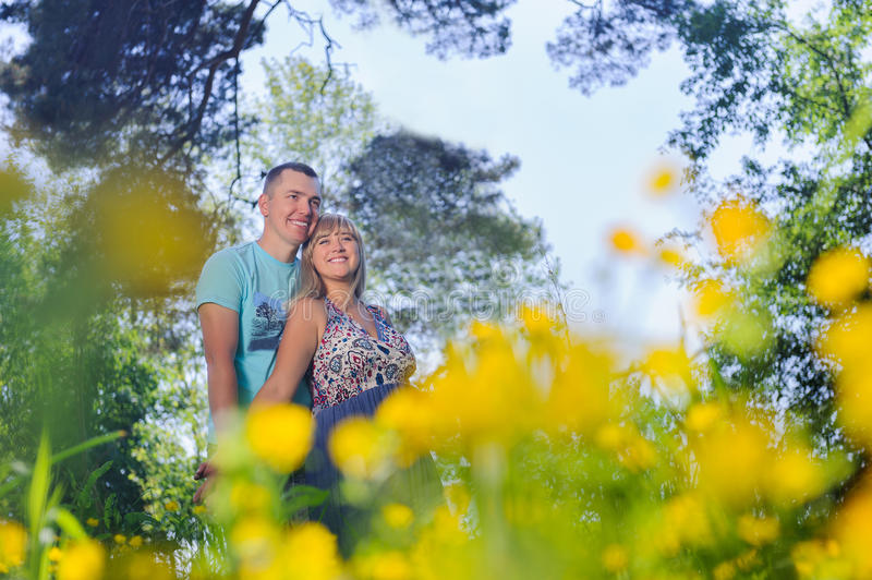 Young happy couple having fun in the park stock photography
