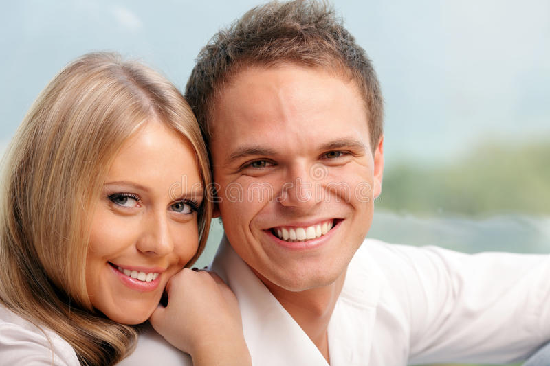 Young Happy Couple Hugging At Home Royalty Free Stock Photo