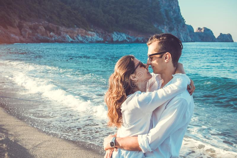 Young happy couple hugging on tropical beach royalty free stock photo