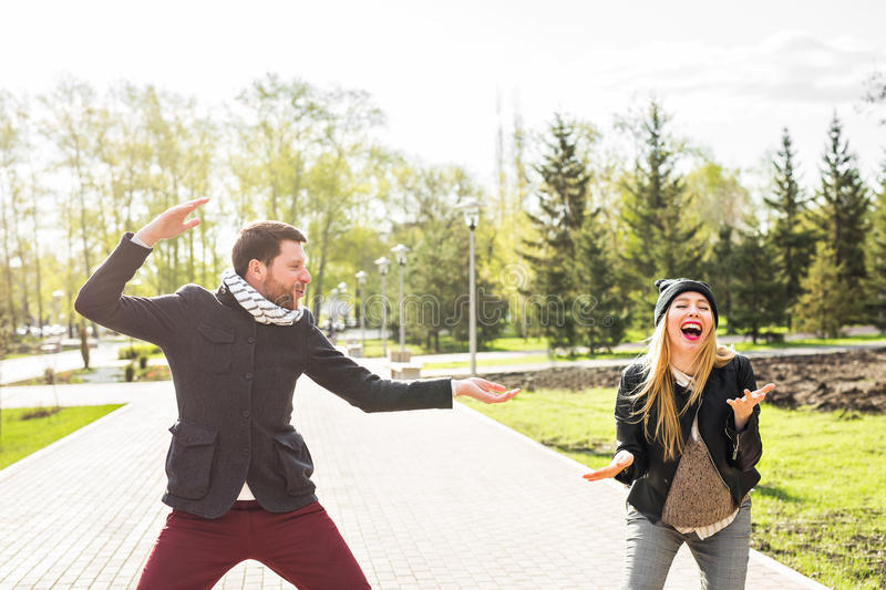 Young happy couple laughing.Man and woman fooling around in the park. Young happy couple laughing.Man and women fooling around in the park royalty free stock photography