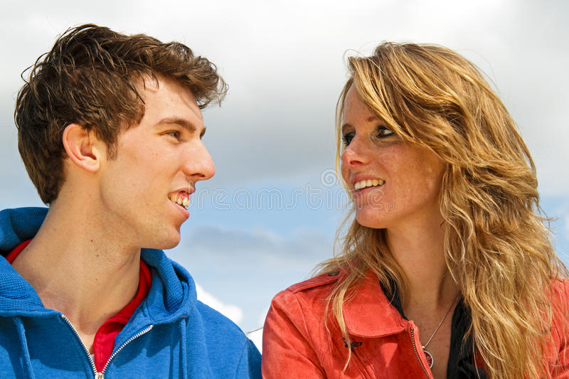 Young happy couple in nature royalty free stock photo