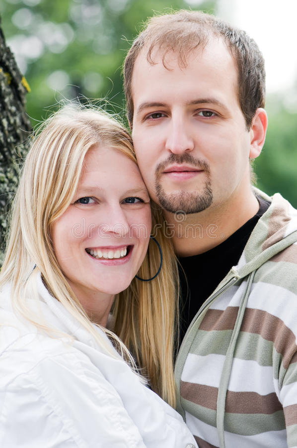 Young happy couple outdoors royalty free stock image