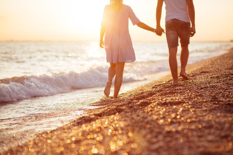 Young happy couple on seashore. stock images