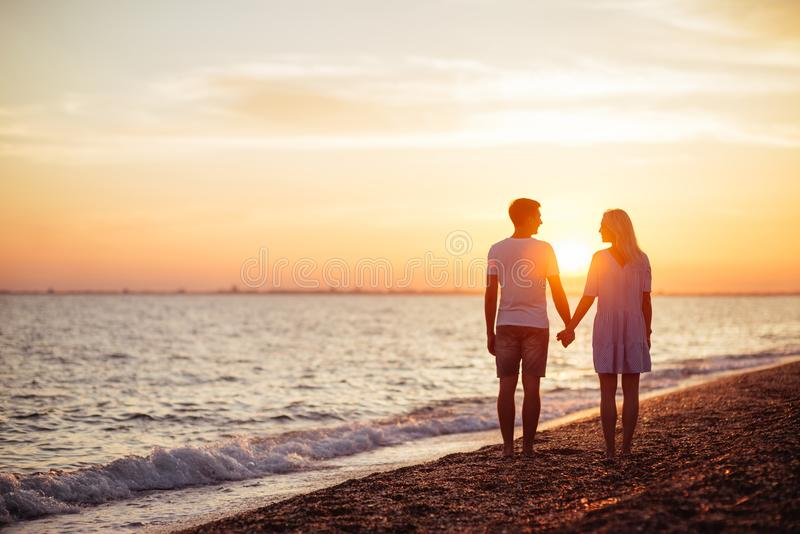 Young happy couple on seashore. royalty free stock photography