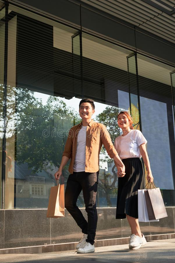 Young happy couple with shopping bags in the city stock image
