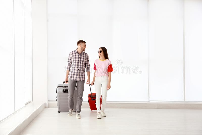 Young couple with suitcases in airport stock photo