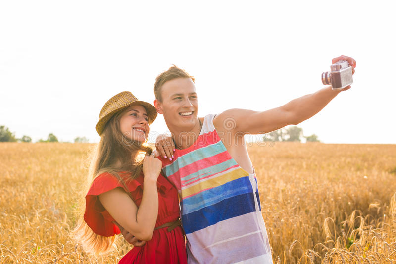 Young happy couple taking a selfie in the field.  royalty free stock image