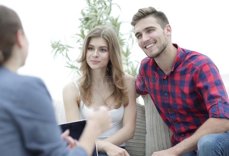 Young happy couple at therapy session with family psychologist. Young couple at therapy session with family psychologist. photo with copy space stock images