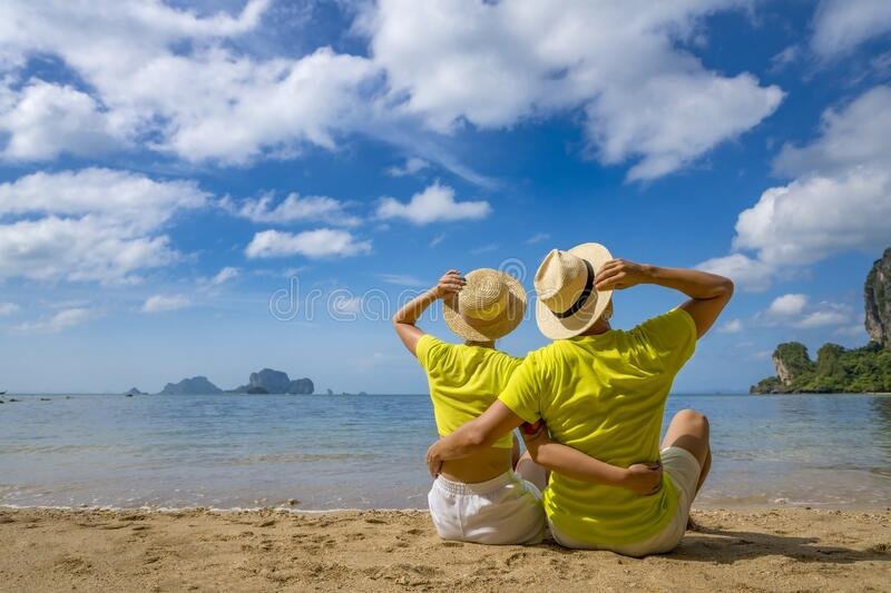 Young happy couple on tropical beach at summer vacation. Thailand.  stock photo