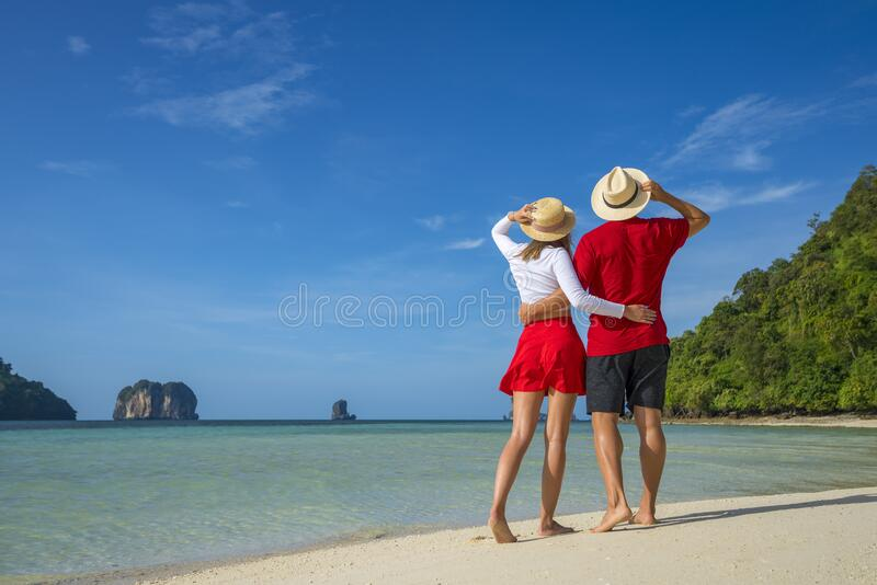 Young happy couple on tropical beach at summer vacation. Thailand.  royalty free stock image