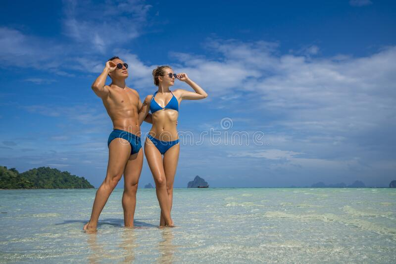 Young happy couple on tropical beach at summer vacation. Thailand.  stock images