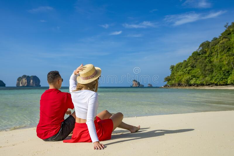 Young happy couple on tropical beach at summer vacation. Thailand.  royalty free stock images