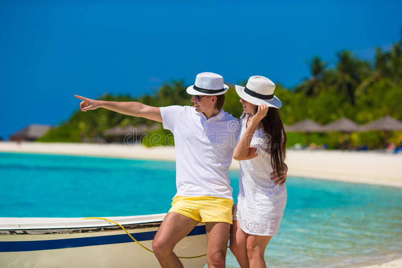 Young happy couple on white beach at summer. Young happy couple have fun on summer tropical vacation stock photos