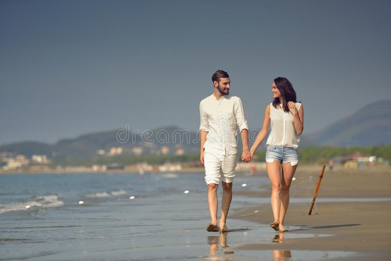 Young happy couple on white beach at summer vacation royalty free stock images