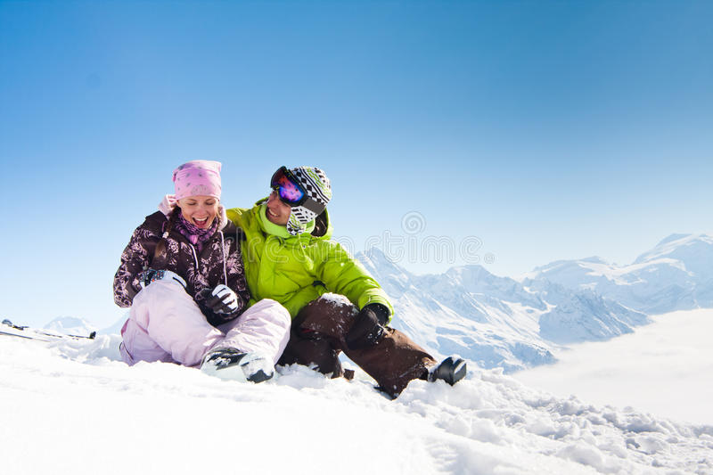 Young happy couple in winter mountains stock images