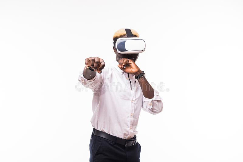Young happy and excited afro american man wearing virtual reality vr 360 vision goggles enjoying video game isolated on clear back royalty free stock photos