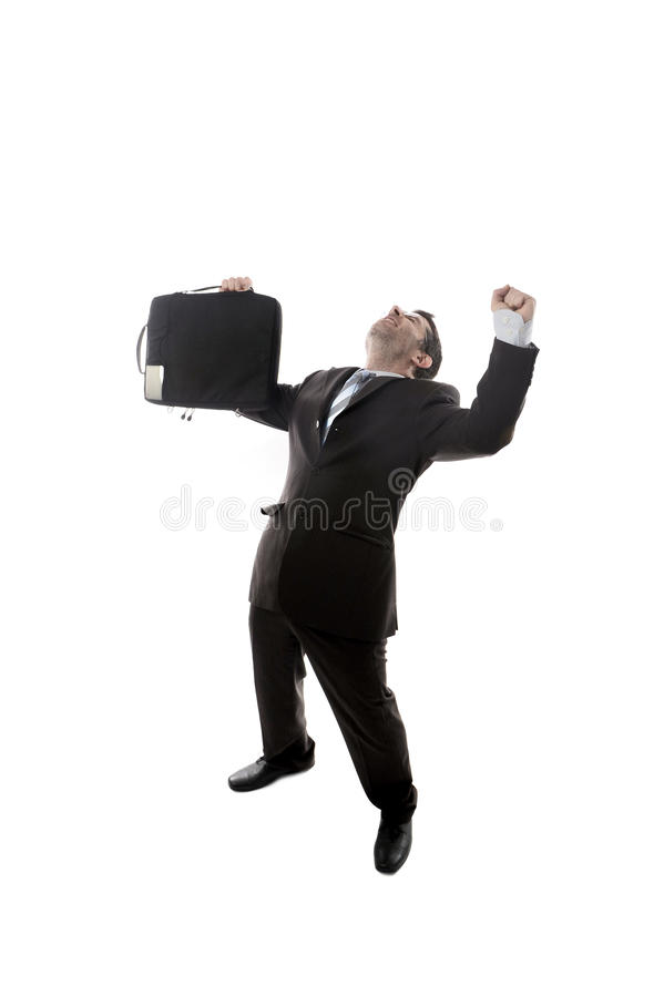 Young happy and excited businessman holding suitcase celebrating promotion and success at work stock photography