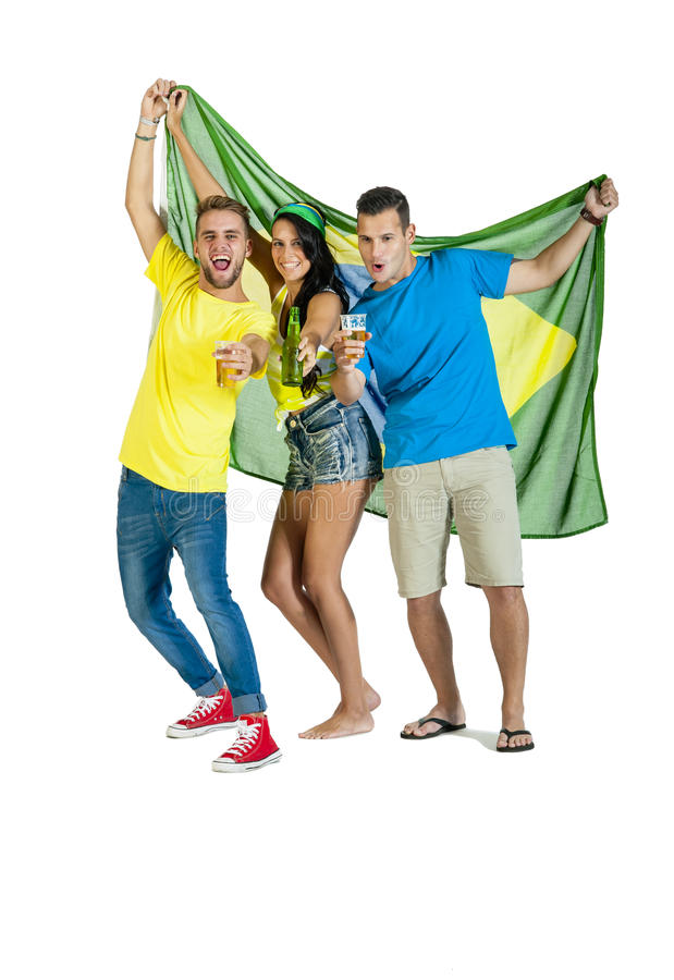 Young happy excited group of Brazil Supporters with Flag and beers. Happy excited group of Brazil Supporters with Flag and beers isolated on white stock photo