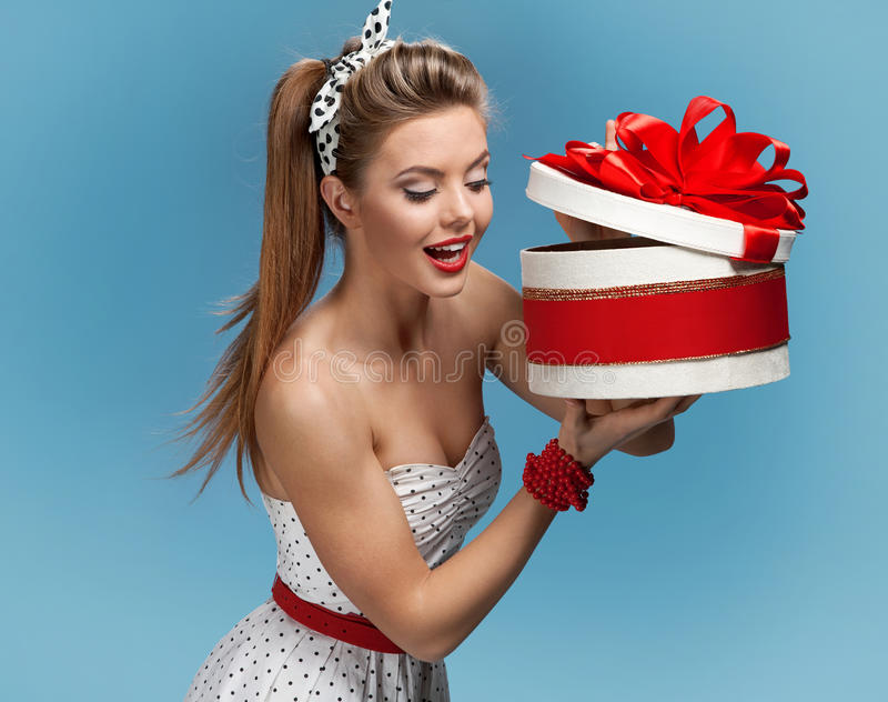 Young happy excited woman open gift box. Holidays, holiday, celebration, birthday and happiness concept stock photos