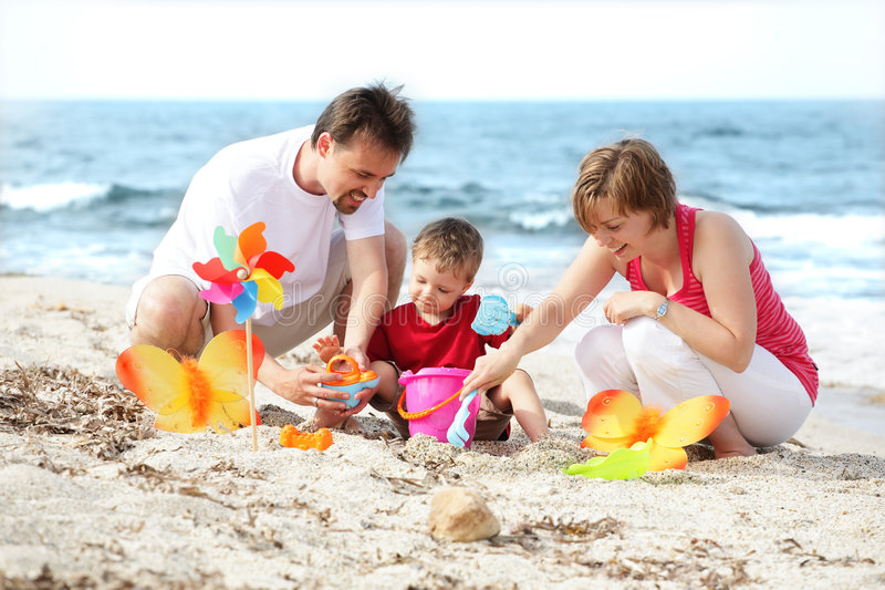 Young happy family on the beach. Family lifestyle portrait