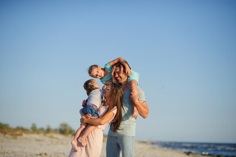 Young happy family on the beach. stock photo
