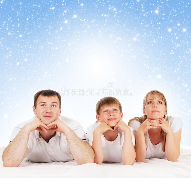 Download A Young And Happy Family On A Blue Background Stock Photo - Image: 22250406