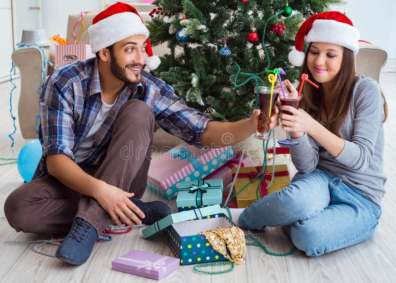 Young happy family celebrating christmas stock photos