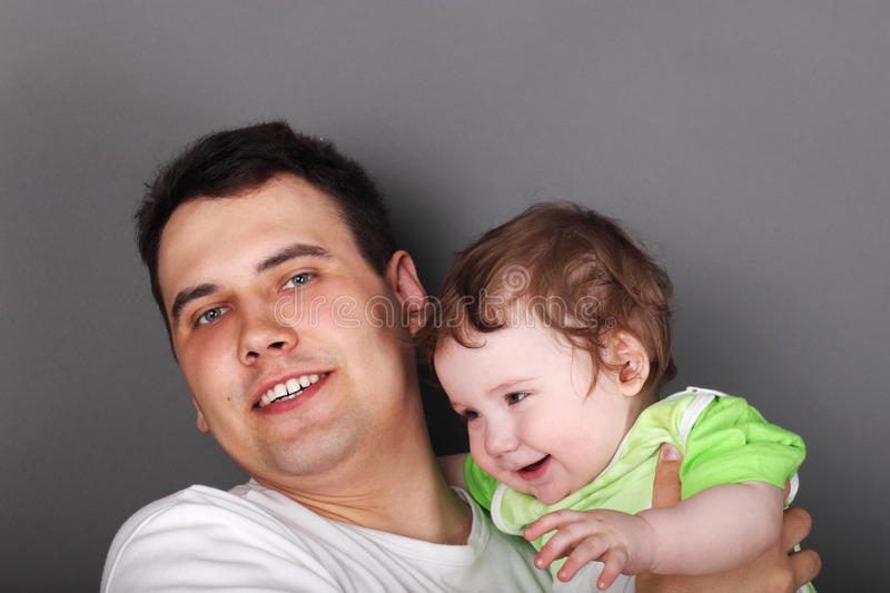 Young happy father holds his little son royalty free stock images