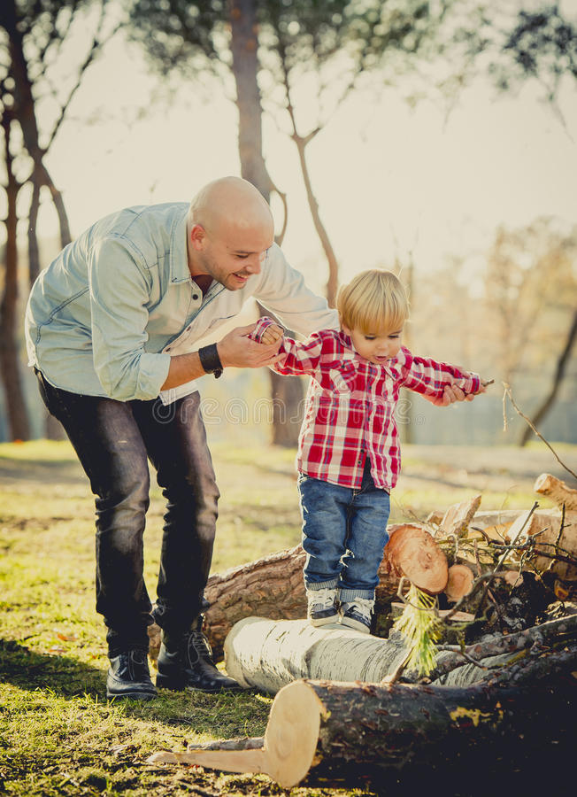 Young happy father playing with excited little cute son walking royalty free stock image