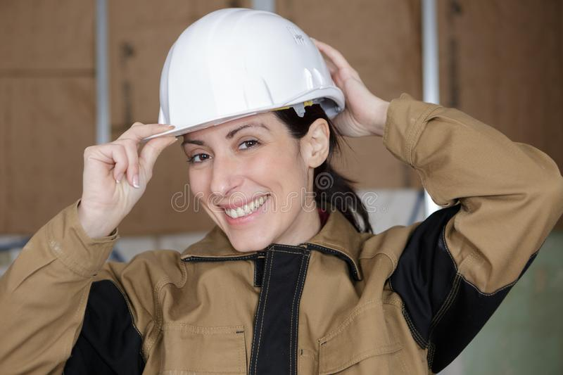 Young happy female builder royalty free stock photography