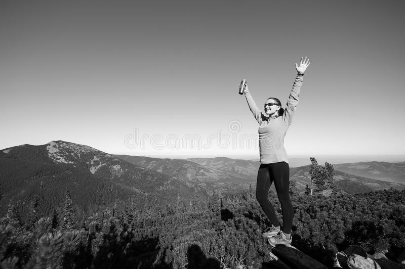 Young happy female hiker at the mountain top royalty free stock images