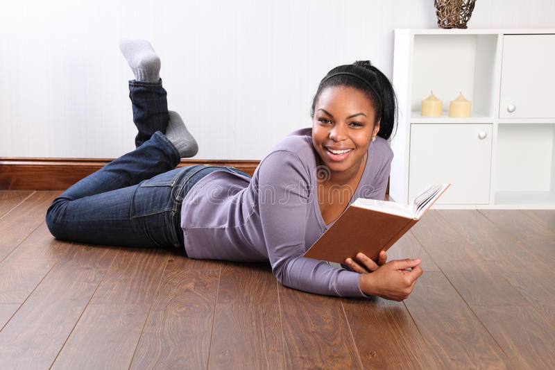 Download Young Happy Female Student Reading Book At Home Stock Image - Image: 18303137