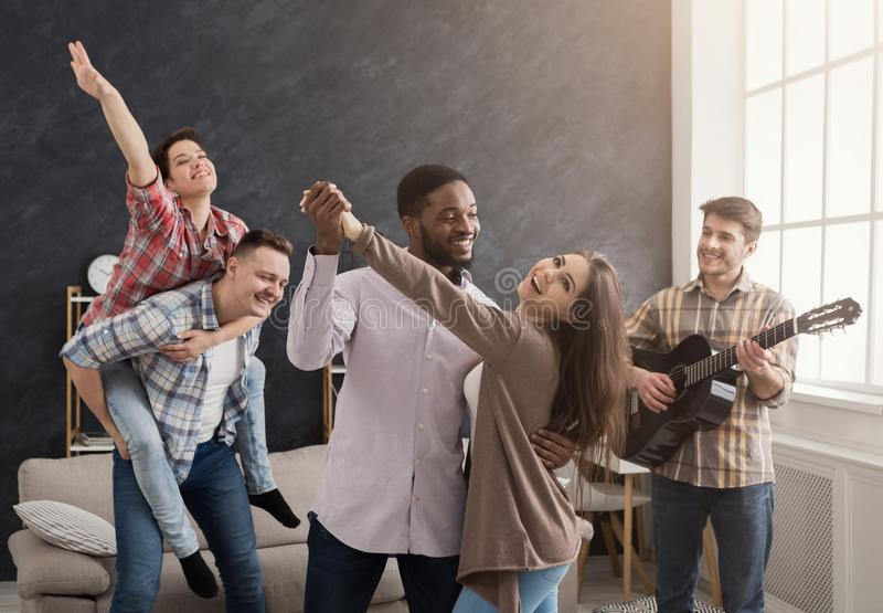 Young happy friends having party at home stock image
