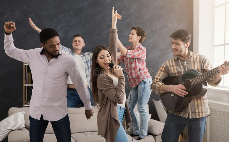 Young happy friends having party at home stock images