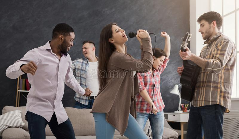 Young happy friends having party at home royalty free stock image