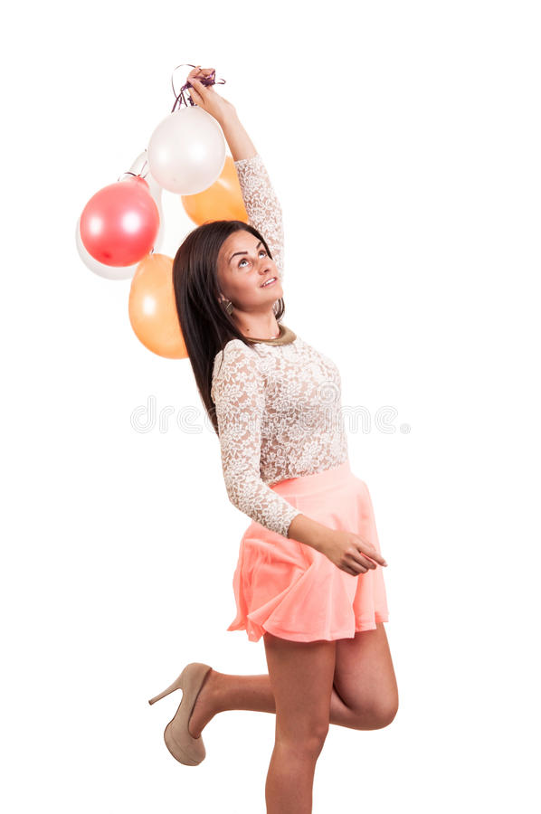 Young happy girl with a bunch of colored balloons royalty free stock photos