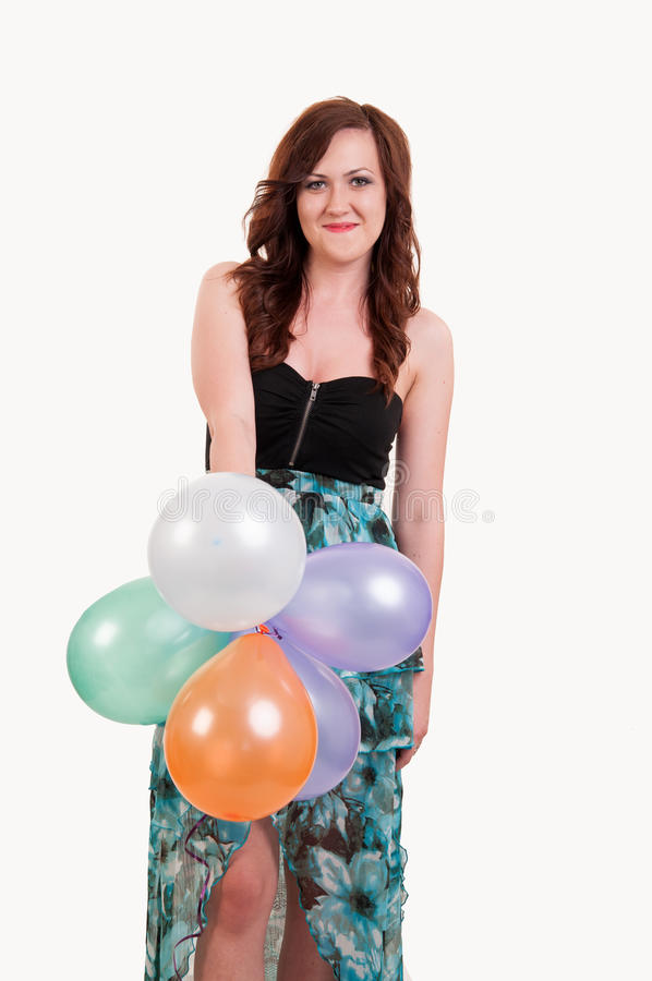 Young happy girl with a bunch of colored balloons royalty free stock photo