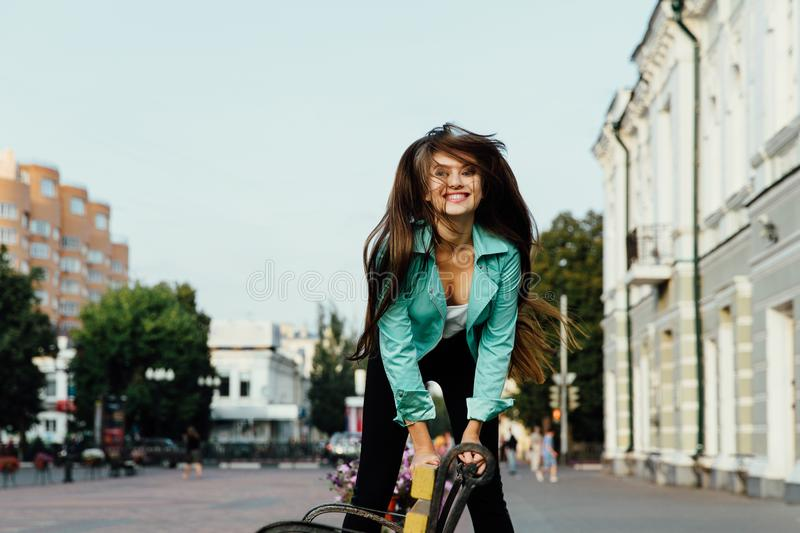 Young happy girl, having fun, jumps and has fun on the street. Lifestyle. stock photography