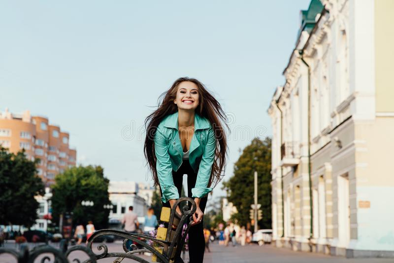 Young happy girl, having fun, jumps and has fun on the street. Lifestyle. stock image