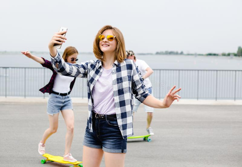 Young happy girl in hipster making selfie on phone.  royalty free stock photos