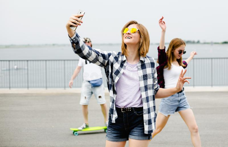 Young happy girl in hipster making selfie on phone.  stock photography
