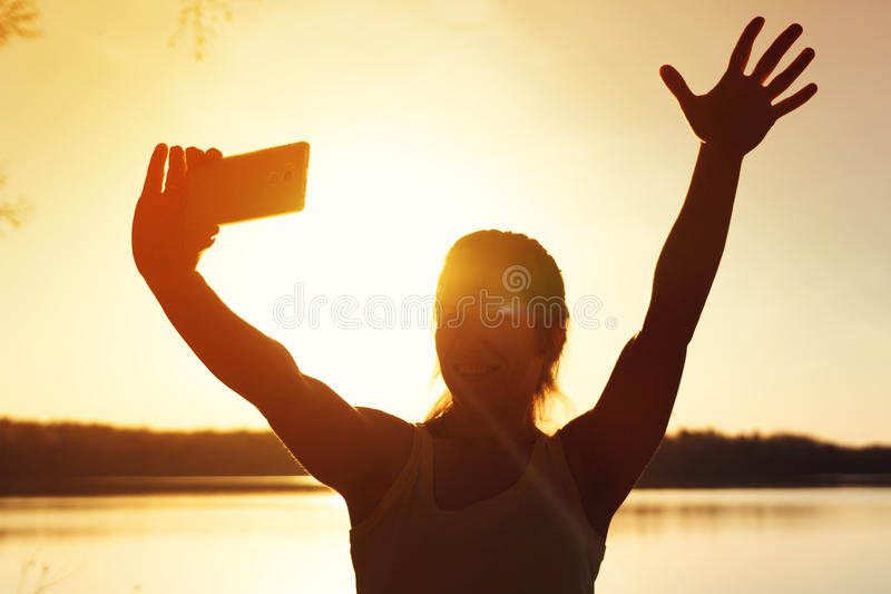 Young happy girl making selfie picture outdoors stock photos