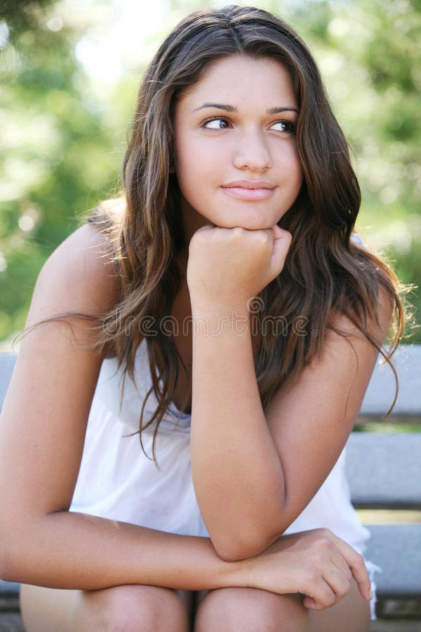 Young happy girl posing outdoor. royalty free stock images