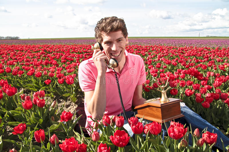 Young happy guy making a phone call royalty free stock image